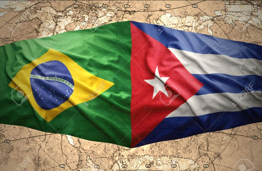 Waving Brazilian and Cuban flags on the of the political map of the world